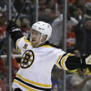 Boston Bruins defenseman Dougie Hamilton reacts after scoring during the first period of Game 3 of a first-round NHL hockey playoff series against the Detroit Red Wings in Detroit, Tuesday, April 22, 2014. (AP Photo/Carlos Osorio)
