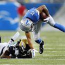 Jacksonville Jaguars free safety Winston Guy (22) tackles Detroit Lions wide receiver Golden Tate (15) in the first half of a preseason NFL football game at Ford Field in Detroit, Friday, Aug. 22, 2014 The Associated Press