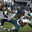 Philadelphia Eagles wide receiver Jeremy Maclin (18) is tackled by Dallas Cowboys' Rolando McClain, rear, after grabbing a pass during the first half of an NFL football game, Thursday, Nov. 27, 2014, in Arlington, Texas. Cowboys' Orlando Scandrick, left,