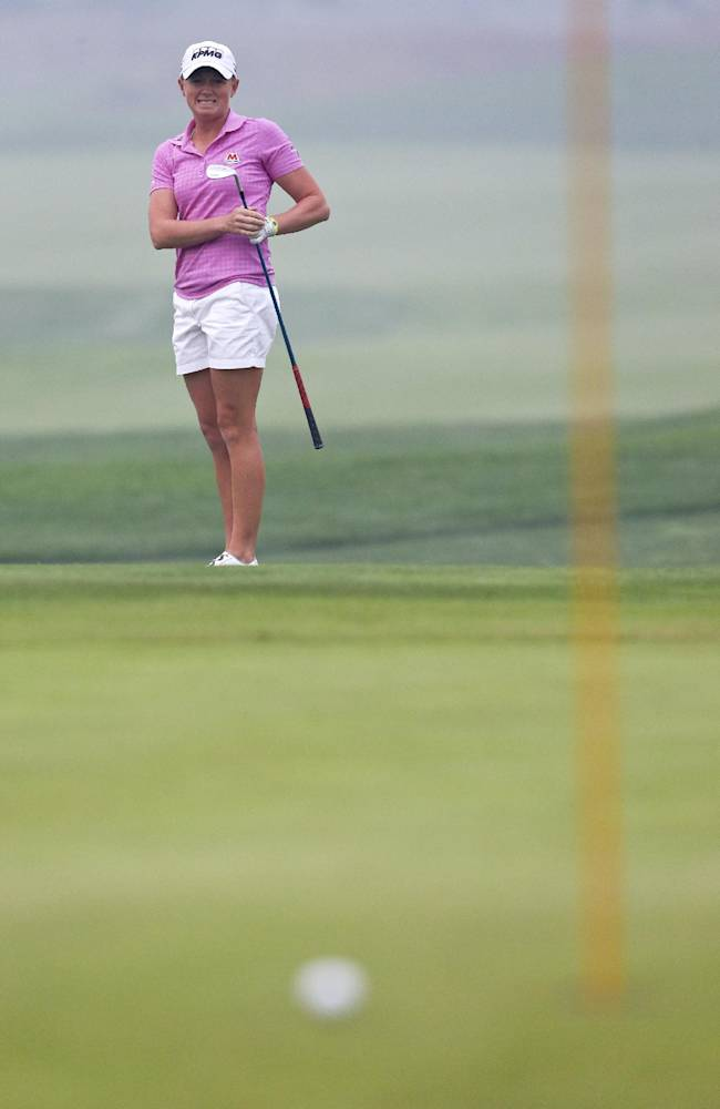 United States' Stacy Lewis reacts after missing a birdie putt during the third round of the Reignwood LPGA Classic golf tournament at Pine Valley Golf Club on the outskirts of Beijing, China, Saturday, Oct. 5, 2013