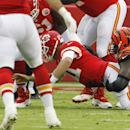 Kansas City Chiefs quarterback Alex Smith (11) loses the ball as he is tackled by Cincinnati Bengals defensive end Robert Geathers (91) in the first half of an NFL preseason football game Thursday, Aug. 7, 2014, in Kansas City, Mo. The Bengals recovered t