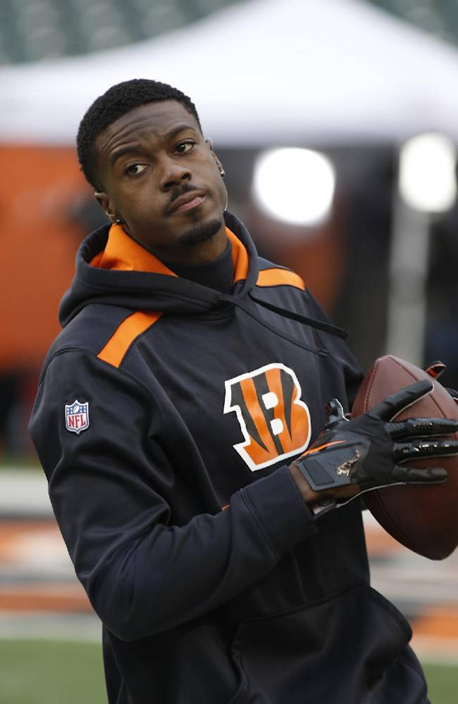 Cincinnati Bengals wide receiver A.J. Green warms up before an NFL wild-card playoff football game against the San Diego Chargers Sunday, Jan. 5, 2014, in Cincinnati