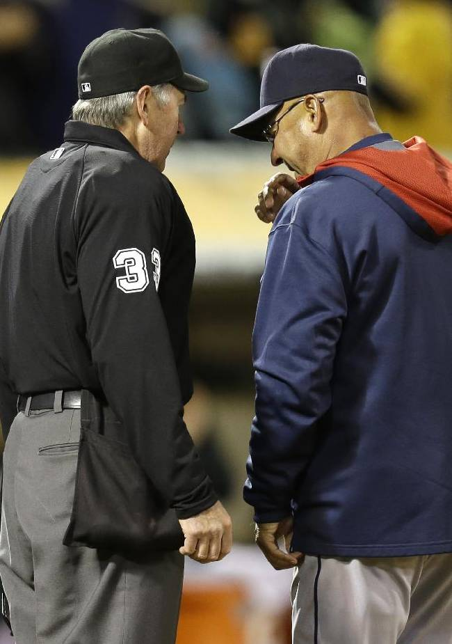 In this March 31, 2014 file photoi, Cleveland Indians manager Terry Francona, right, contests a play at the plate with umpire Mike Winters in the sixth inning of a baseball game against the Oakland Athletics in Oakland, Calif. With baseball's expanded replay rule this season, those colorful, saliva-trading tirades Bobby Cox and Lou Piniella made famous could very well be replaced by far more civilized behavior