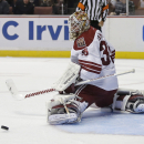 Arizona Coyotes goalie Louis Domingue deflects a shot during the second period of an NHL hockey preseason game against the Anaheim Ducks in Anaheim, Calif., Tuesday, Sept. 23, 2014. The Associated Press
