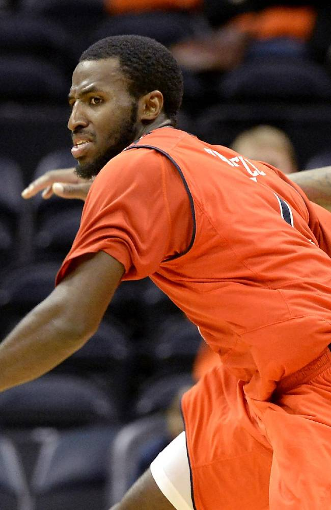 Auburn guard KT Harrell, left,  and Illinois guard Rayvonte Rice  chase a rebound in the second half of an NCAA college basketball game on Sunday, Dec. 8, 2013, in Atlanta. Illinois won 81-62