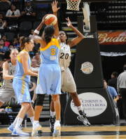 SAN ANTONIO, TX - May 30:  Swin Cash #8 of the Chicago Sky shoots against Shameka Christon #20 of the San Antonio Silver Stars at AT&T Center on May 30 2012 in San Antonio, Texas