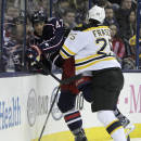 Boston Bruins' Matt Fraser, right, checks Columbus Blue Jackets' Dalton Prout during the first period of an NHL hockey game Saturday, Dec. 27, 2014, in Columbus, Ohio. (AP Photo/Jay LaPrete)