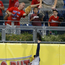 Howard's RBI hit in 15th lifts Phils over Astros The Associated Press