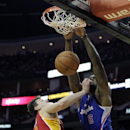 Los Angeles Clippers center DeAndre Jordan (6) is fouled by Houston Rockets center Omer Asik (3) during the second quarter of an NBA basketball game, Saturday, March 29, 2013, in Houston The Associated Press
