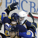 St. Louis Blues' Vladimir Tarasenko (91) congratulates goalie Ryan Miller after his first home victory of an NHL hockey game against the Tampa Bay Lightning, Tuesday, March 4, 2014 in St. Louis. St. Louis beat Tampa Bay 4-2 The Associated Press