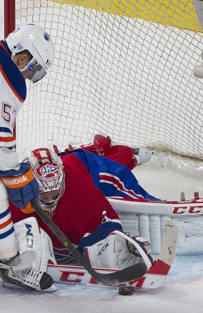 Montreal Canadiens' goaltender Carey Price makes a save against Edmonton Oilers' David Perron during the first period of an NHL hockey game in Montreal, Tuesday, Oct. 22, 2013
