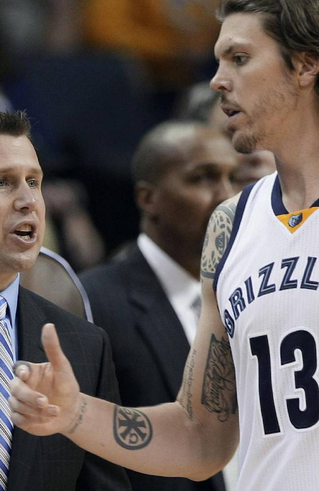 Memphis Grizzlies coach David Joerger, left, talks to Mike Miller during overtime in an NBA basketball game against the Detroit Pistons in Memphis, Tenn., Friday, Nov. 1, 2013. The Grizzlies won 111-108