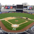 In this photo provided by the New York Yankees, a grounds crew converts the baseball diamond to a soccer field at Yankee Stadium in New York, Thursday, July 19, 2012. In the very first soccer match played at the new stadium, Chelsea FC plays Paris-Saint Germain on Sunday, July 22. (AP Photo/New York Yankees)