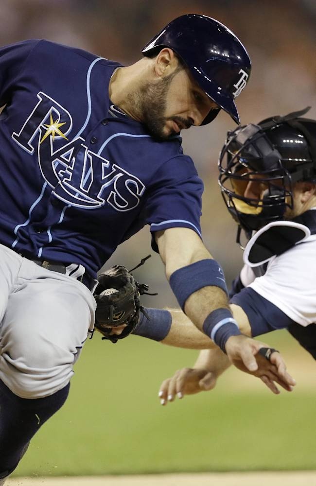 Tampa Bay Rays' Sean Rodriguez is tagged out by Detroit Tigers catcher Bryan Holaday during the seventh inning of a baseball game in Detroit, Sunday, July 6, 2014. (AP Photo/Carlos Osorio)