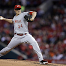 Cincinnati Reds starting pitcher Homer Bailey throws during the first inning of a baseball game against the St. Louis Cardinals on Tuesday, April 8, 2014, in St. Louis The Associated Press