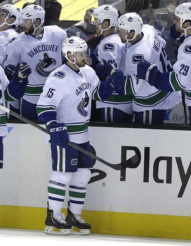 Canucks snap 9-game skid vs. Sharks with 4-2 win