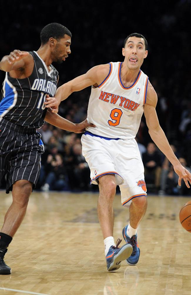 New York Knicks' Pablo Prigioni, right, of Argentina, reacts as he is guarded by Orlando guard Ronnie Price during the second quarter of an NBA basketball game Friday, Dec. 6, 2013, at Madison Square Garden in New York. The Knicks won 121-83