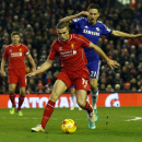 Liverpool's Jordan Henderson, front, takes the ball past Chelsea's Nemanja Matic during the English League Cup semi-final first leg soccer match between Liverpool and Chelsea at Anfield Stadium, Liverpool, England, Tuesday Jan. 20, 2015