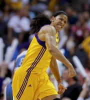 Los Angeles Sparks' Candace Parker reacts after making a basket in Game 2 of the WNBA basketball Western Conference Finals against the Minnesota Lynx in Los Angeles, Sunday, Oct. 7, 2012. (AP Photo/Jae C. Hong)