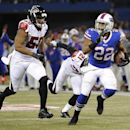 Buffalo Bills running back Fred Jackson (22) scores a touchdown past Atlanta Falcons defensive end Osi Umenyiora (50) during the second half of an NFL football game on Sunday, Dec. 1, 2013, in Toronto The Associated Press