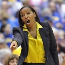 FILE - In this March 10, 2012, file photo, UNC-Wilmington coach Cynthia Cooper-Dyke calls to her team during an NCAA college basketball game against Delaware in Upper Marlboro, Md. Cooper-Dyke is returning to Southern California as the Trojans' women's basketball coach. USC hired Cooper-Dyke on Thursday, April 11, 2013, to replace Michael Cooper, who quit last month after four seasons. (AP Photo/Gail Burton, File)