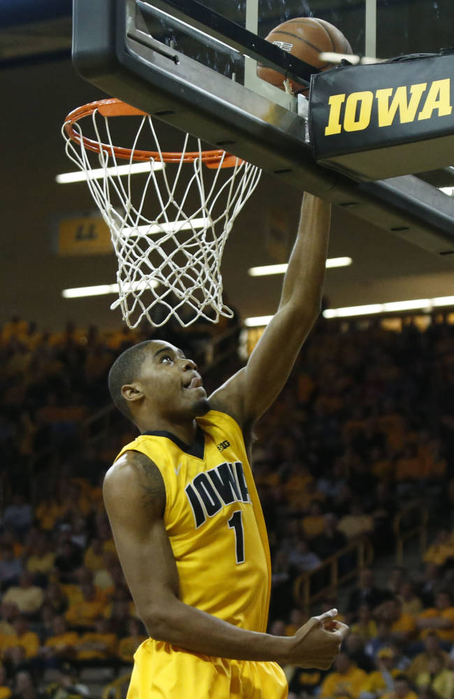 Iowa forward Melsahn Basabe makes a basket during the first half of an NCAA college basketball game against Ohio State at Carver-Hawkeye Arena in Iowa City, Iowa, on Tuesday, Feb. 4, 2014