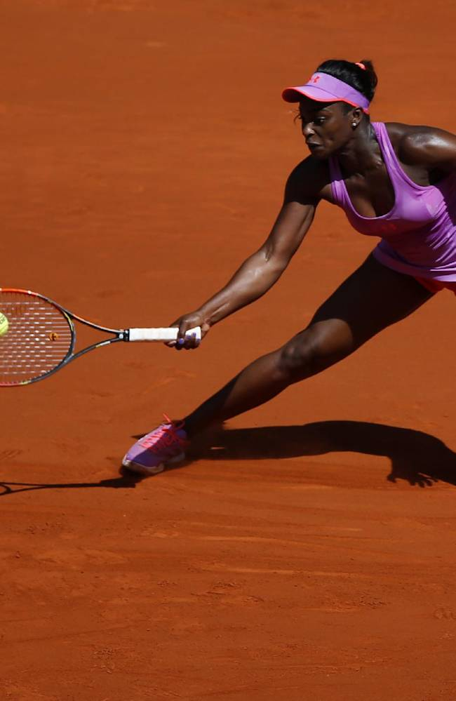 Sloane Stephens from the U.S.  returns the ball during a Madrid Open tennis tournament match against Na Li from China in Madrid, Spain, Thursday, May 8, 2014
