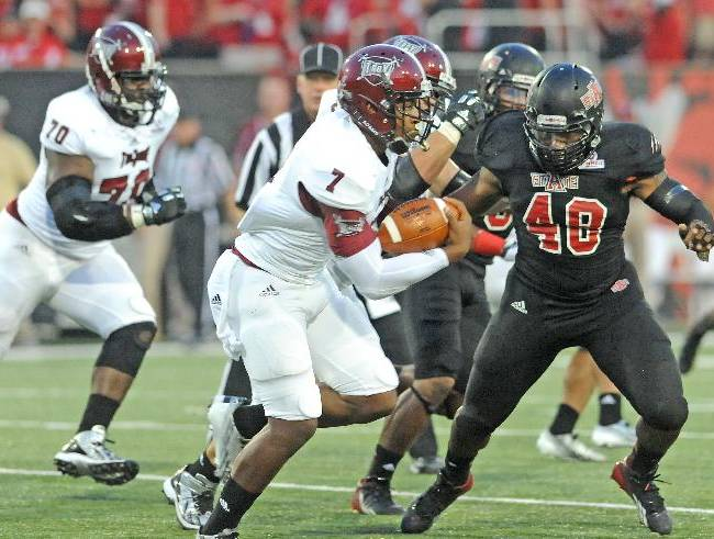 Troy (Ala.) University's quarterback Deon Anthony runs the ball on Thursday, Sept. 12, 2013 during an NCAA college football game in Jonesboro, Ark. against the Arkansas State Unviersity Red Wolves. Arkansas State defeated Troy 41-34