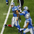 Detroit Lions quarterback Matthew Stafford (9) reacts after scoring a touchdown during the third quarter of an NFL football game against the New York Giants in Detroit, Monday, Sept. 8, 2014 The Associated Press
