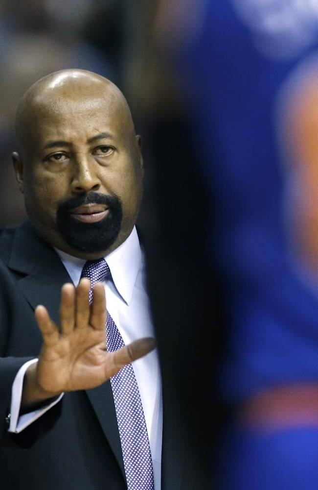 New York Knicks head coach Mike Woodson looks towards guard J.R. Smith (8) during the first half of an NBA basketball game against the Detroit Pistons in Auburn Hills, Mich., Tuesday, Nov. 19, 2013