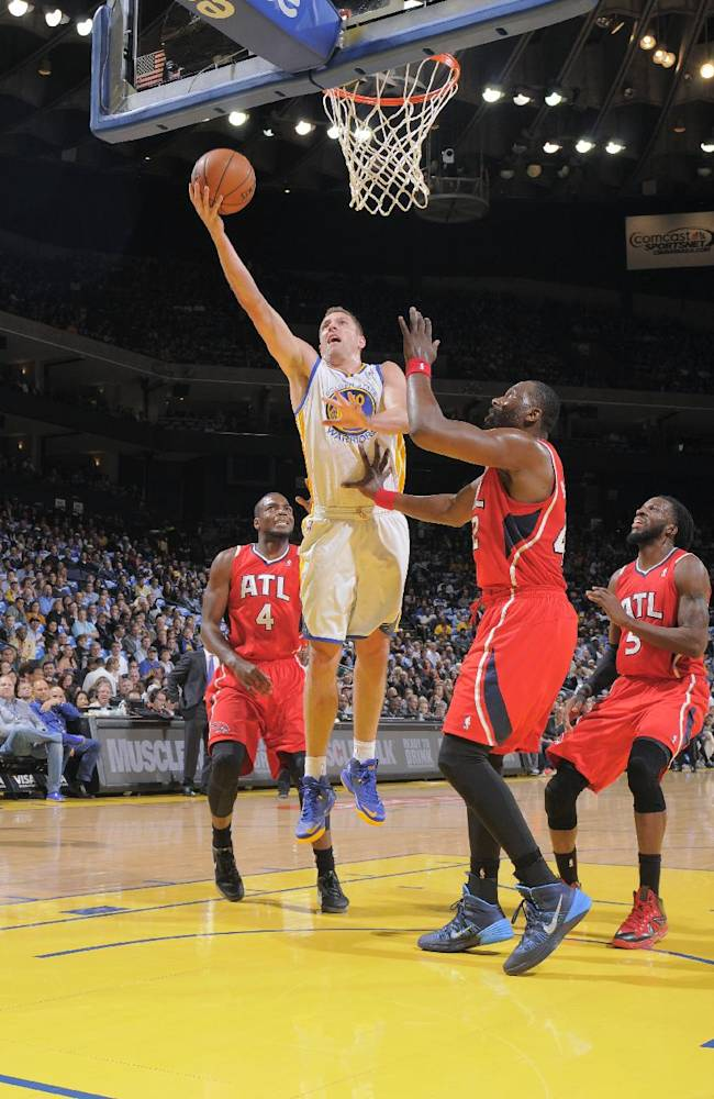 Warriors ease past Hawks 111-97 in return home