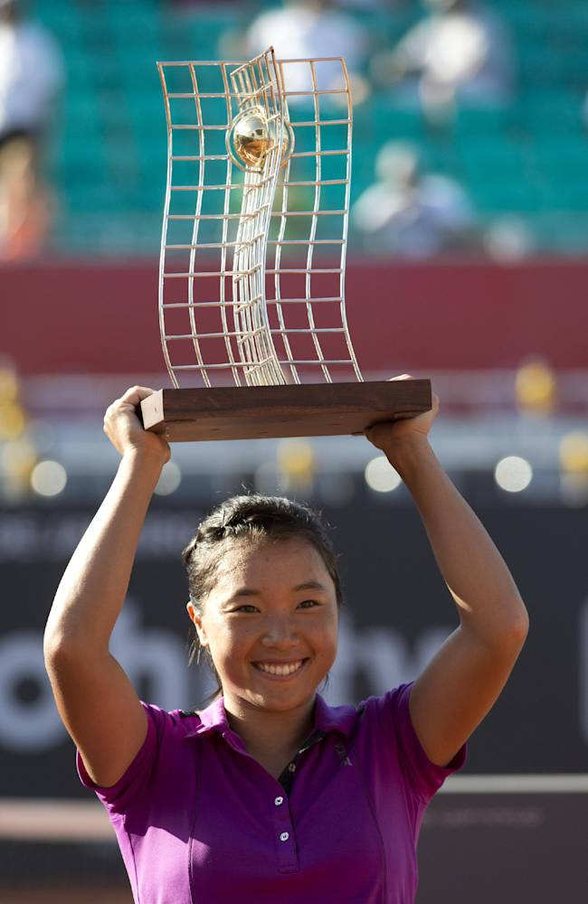 Kurumi Nara of Japan, holds up her trophy after defeating Klara Zakopalova of the Czech Republic at the Rio Open tennis tournament in Rio de Janeiro, Brazil, Sunday, Feb.23, 2014