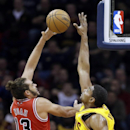Cleveland Cavaliers' Andrew Bynum, right, goes up to block a shot by Chicago Bulls' Joakim Noah (13) in the first quarter of an NBA basketball game Saturday, Nov. 30, 2013, in Cleveland The Associated Press