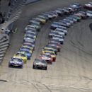 The field, headed by pole sitter Denny Hamlin, front left, and Martin Truex Jr., front right, begins the NASCAR Sprint Cup series auto race, Sunday, May 31, 2015, at Dover International Speedway in Dover, Del. (AP Photo/Nick Wass)