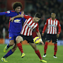 Manchester United's Marouane Fellaini, left, in action with Southampton's Shane Long during their English Premier League soccer match between Southampton and Manchester United at St Mary's stadium in Southampton, England, Monday, Dec. 8, 2014