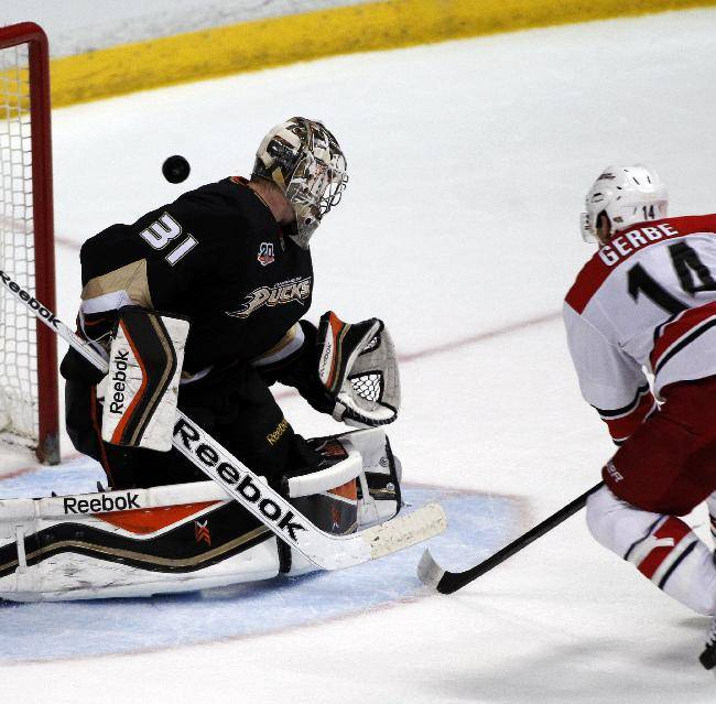 Anaheim Ducks goalie Frederik Andersen (31), of Denmark, deflects a shot by Carolina Hurricanes left wing Nathan Gerbe (14) during the third period of an NHL hockey game Sunday, March 2, 2014, in Anaheim, Calif. The Ducks won 5-3