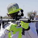 Atlanta Falcons' Devin Hester looks at a rifle after a practice session at Luke Air Force Base for the NFL Football Pro Bowl Thursday, Jan. 22, 2015, in Glendale, Ariz The Associated Press