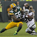 In this Aug. 22, 2014, file photo, Green Bay Packers defensive end Julius Peppers hits Oakland Raiders running back Darren McFadden during an NFL preseason football game Friday Aug. 22, 2014, in Green Bay, Wis. The NFL is a young man's game, but from Juli