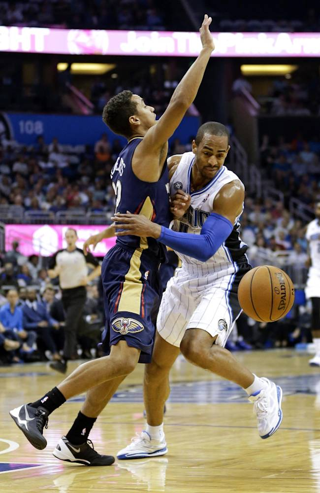 Orlando Magic's Arron Afflalo, right, momentarily loses the ball after running into New Orleans Pelicans' Brian Roberts during the first half of an NBA basketball game in Orlando, Fla., Friday, Nov. 1, 2013
