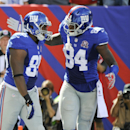 New York Giants tight end Larry Donnell (84) celebrates with Daniel Fells (85) after Fells caught a pass for a touchdown during the second half of an NFL football game against the Arizona Cardinals on Sunday, Sept. 14, 2014, in East Rutherford, N.J The As