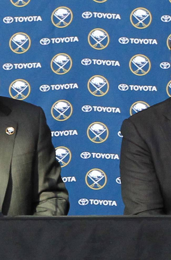 Tim Murray, right, addresses the media after being named as the new General Manager of the Buffalo Sabres, Thursday, Jan. 9, 2014, at First Niagara Center in Buffalo, N.Y. At left is Pat Lafontaine, President of Hockey Operations for the Sabres