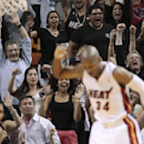 Miami Heat fans celebrate after Ray Allen scored in the final minute of an NBA basketball game against the Memphis Grizzlies in Miami, Friday, March 21, 2014. The Heat won 91-86 The Associated Press