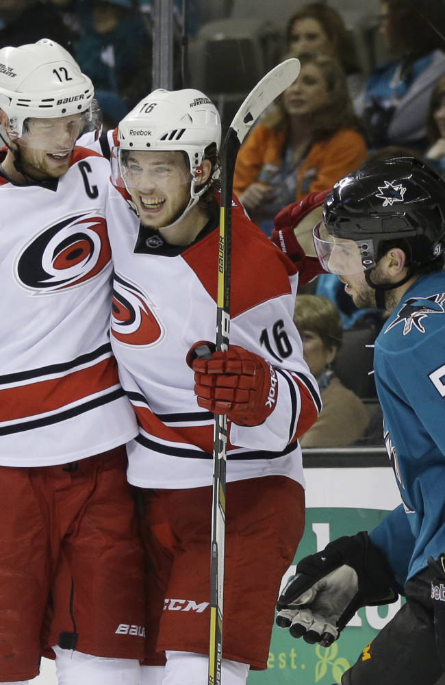 Carolina Hurricanes' Elias Lindholm (16), of Swedend celebrates goal next to San Jose Sharks' Jason Demers (5) and teammate Eric Staal during the second period of an NHL hockey game on Tuesday, March 4, 2014, in San Jose, Calif