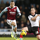 In this Saturday, Nov. 30, 2013 file photo, West Ham United's Ravel Morrison, left, controls the ball past Fulham's Scott Parker, during their English Premier League soccer match in London. Police say West Ham midfielder Ravel Morrison has been charged wi
