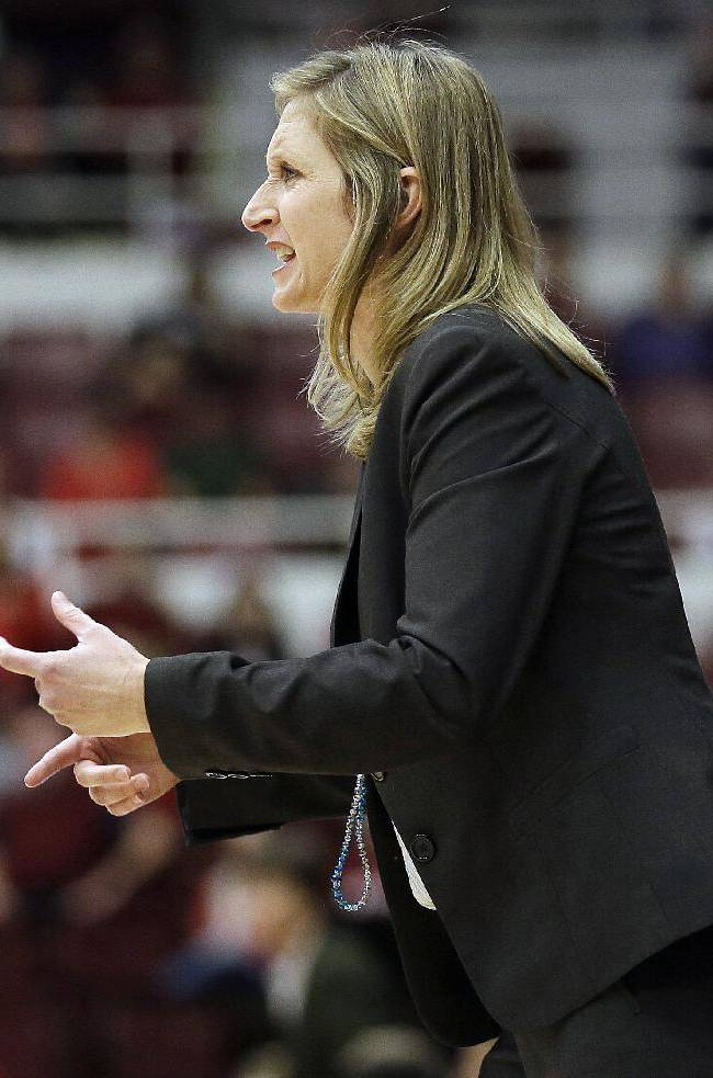UC Davis head coach Jennifer Gross talks to her team from the sideline during the first half of an NCAA college basketball game against Stanford in Stanford, Calif., Sunday, Nov. 17, 2013