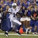 In this Aug. 16, 2014, file photo, Indianapolis Colts' Hakeem Nicks (14) runs following a catch during the first half of an NFL preseason football game against the New York Giants in Indianapolis. Just about any free-agent receiver would be enticed by joi