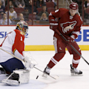 Florida Panthers' Roberto Luongo (1) makes a save on a shot by Phoenix Coyotes' Lauri Korpikoski, of Finland, during the second period of an NHL hockey game, Thursday, March 20, 2014, in Glendale, Ariz The Associated Press