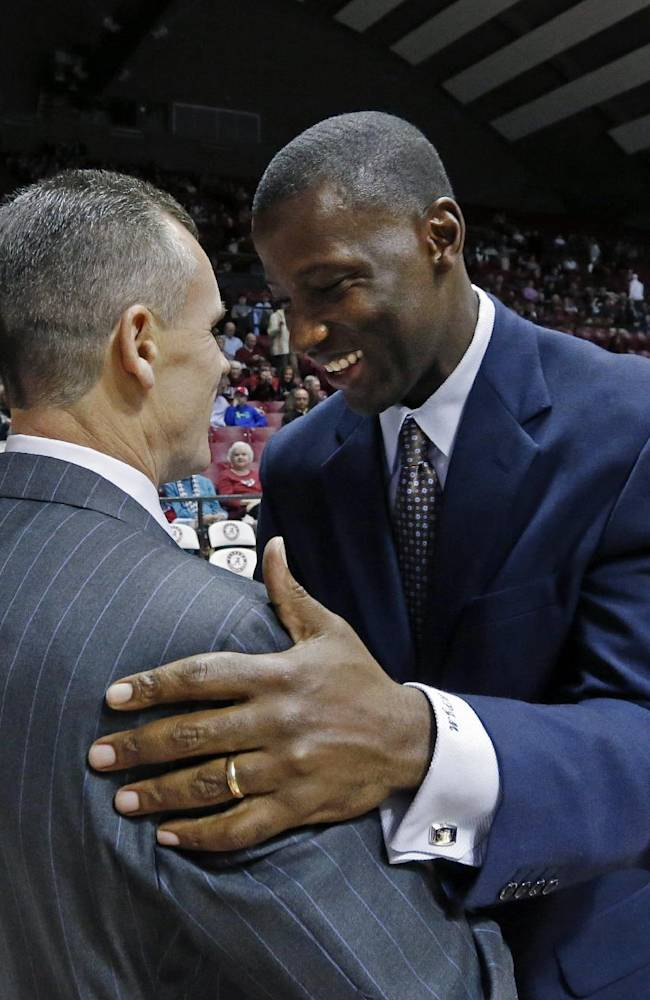Florida coach Billy Donovan, left, and Alabama coach Anthony Grant talk before an NCAA college basketball game at Coleman Coliseum in Tuscaloosa, Ala., Thursday, Jan. 23, 2014. Florida won 68-62