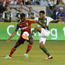 Portland Timbers' Rodney Wallace, right, battles Brandon McDonald (44) of Real Salt Lake during the first half of an MLS Soccer game in Portland, Ore., Wednesday August 21, 2013. (AP Photo/Greg Wahl-Stephens)