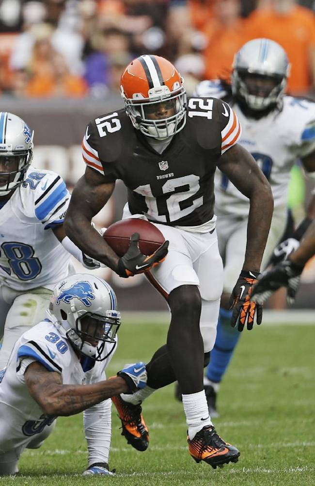In this Sunday, Oct. 13, 2013, file photo, Cleveland Browns wide receiver Josh Gordon (12) breaks away from Detroit Lions defensive back Darius Slay (30) after a reception in the fourth quarter of an NFL football game in Cleveland. Gordon is tired of the trade rumors that have been whipping around him for weeks. With Tuesday's deadline approaching, Gordon could be down to his final days in Cleveland, where the front office insists it has not been shopping him to other teams